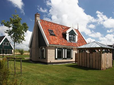Photo for A luxury comfortable villa in Wieringer style in a holiday park, directly situated by the Waddenzee.