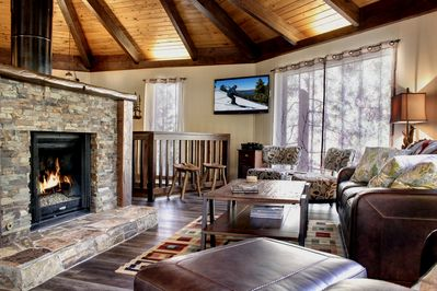 Open floor plan concept with central stone fireplace