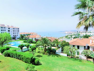 Photo for Apartment overlooking the sea, garden and pool.
