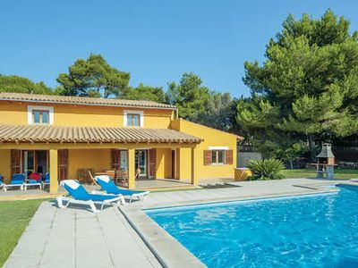 Photo for Mallorcan-style villa w/ large terrace + pool, 20 min walk to town