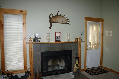 Living Room with Fireplace and Access to Deck via the Door to the  Right.