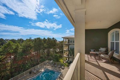 Have a cup of coffee on your spacious private balcony overlooking the pool