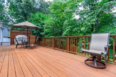 Huge deck surrounded by nature setting. Great for entertaining and grilling out.
