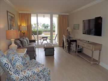Privately owned Marco Beach Ocean Resort condo with access to the pool area from the patio.