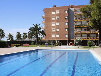 Photo for AT133 ELS PINS I: Apartment on the seafront with communal pool