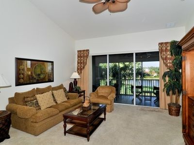 "Spacious living room with vaulted ceiling, plant ledges, 42""Sony HDTV, lake view"