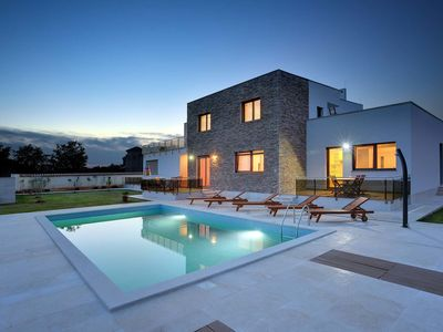 Photo for Modern villa consisting of two apartments with private pool, beach at 1 km