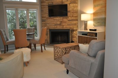 Great room w/fireplace,large transom window gorgeous view&sunset. Ground patio.