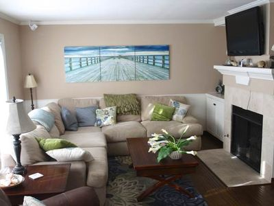 TIME TO ESCAPE THE CITY AND UNWIND IN THIS CONDO JUST STEPS AWAY FROM THE BEACH