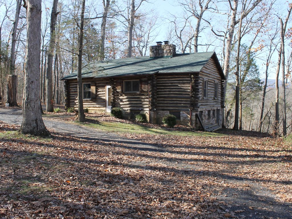 Rustic mountain log cabin perched on a cliff side above for Log cabins in shenandoah valley