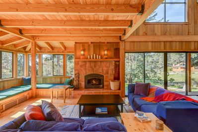 Modern rustic living room with blue couches and fireplace