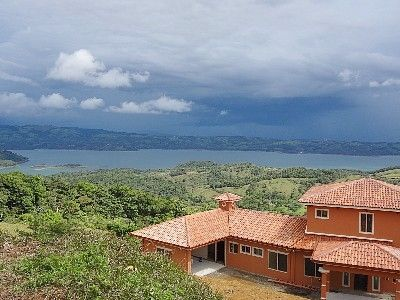 Lake Arenal Luxury home with breathtaking views of the mountain side sunsets