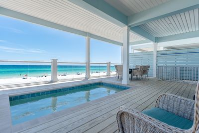 Pool deck and lounge area on the second floor, with an amazing beach view.