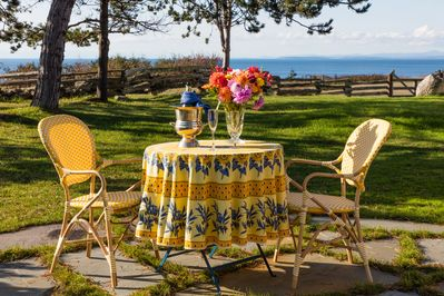 dining outside with a view of the sea on your private patio