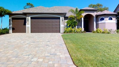 Photo for Golfers Paradise - NW Cape Coral Luxury Electric Heated Pool/Spa Home, right on the western edge of