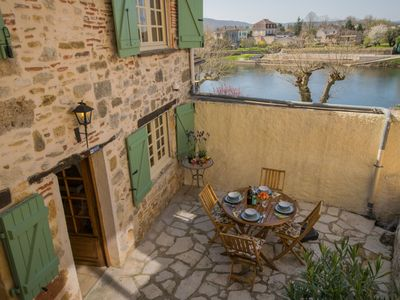 Photo for Authentic city house in the old centre of Puy L'Eveque, directly by the Lot.