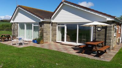 Photo for Two bedroom bungalow with wonderful sea views and a short stroll to the beach