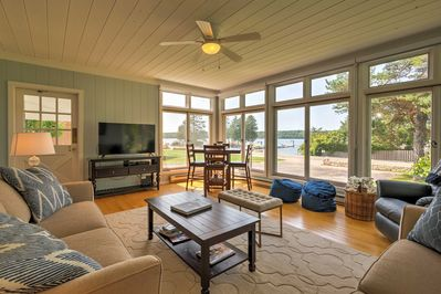 Sit in the sun room, watch TV and enjoy the harbor views!