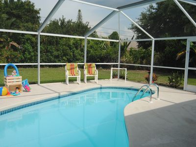 Photo for Top location, heated pool, Wi-Fi, Florida Room, Tropical Garden