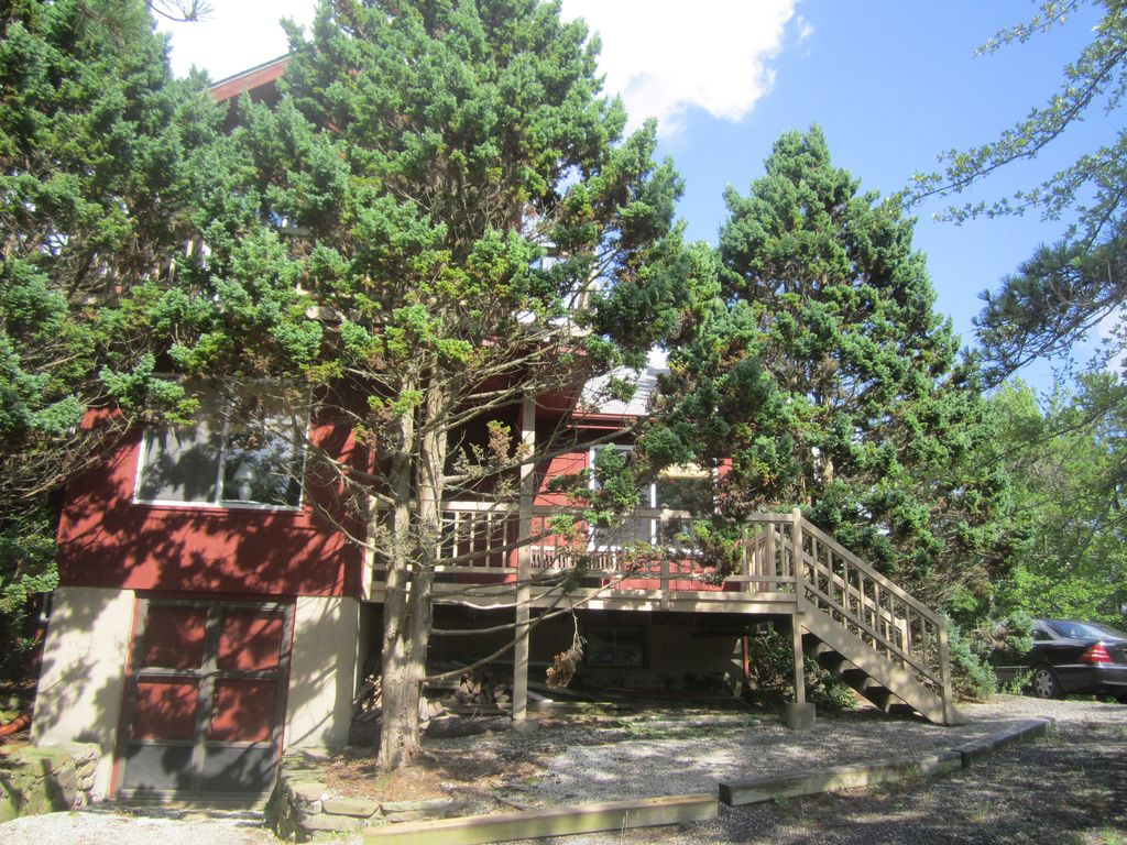 Large lakefront home with a private beach homeaway for Long pond pa cabin rentals