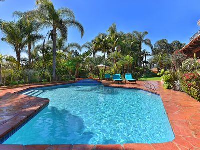 Photo for PRIVATE GROUNDS WITH POOL SURROUNDED BY PALMS TREES!
