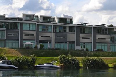 The view of the apartment from across the river