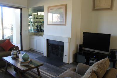 Fireplace, wet bar and entertainment area.