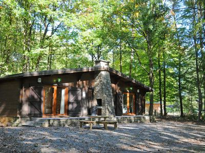 Photo for Completely renovated chalet with wood stove and four bedrooms, in a wooded park