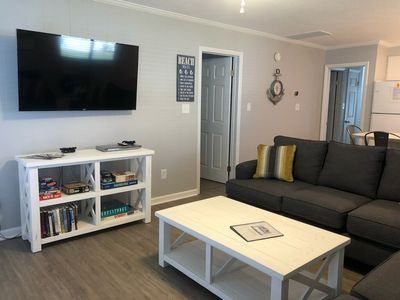 Open concept living room, two full-sized couches, 55 inch WiFi Roku TV