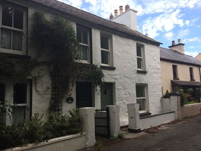 Photo for 'Breesha's Cottage' is a traditional Manx stone cottage in Ballaugh Village.