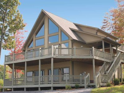 Photo for Warm & Cozy chalet w/ lake access, hot tub, fire pit, & mountain views!