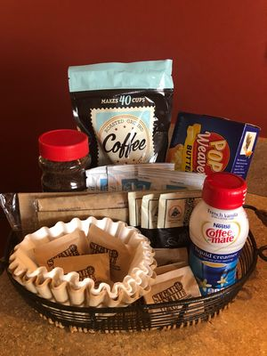 Your welcome basket awaits. Coffee, hot chocolate, bottled water, and snacks.