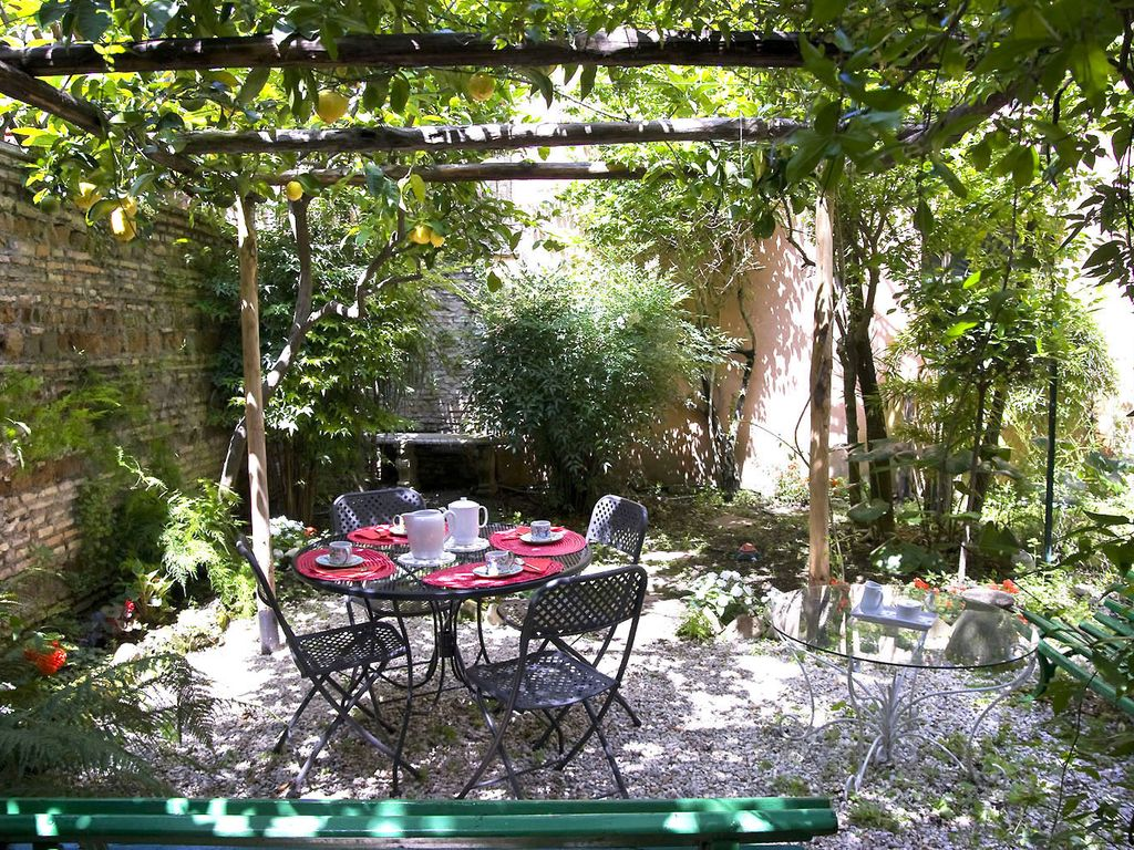 Rome with a garden delightful 1 bedroom apartment with private trastevere condo rental with a wisteria covered arbor and a lemon trees sciox Gallery