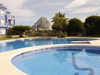 Photo for Calpe: Apartment with views to the sea and Rock, swimming pool, free wifi, parking and a / c