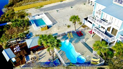 Photo for 6BR/6BA Heated Pool, FirePit, Hammocks, Easy Beach Access, Private Boat Dock!