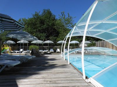 Photo for Castelwood: luxury chalets with swimming pool, at the foot of Chateau Biron.
