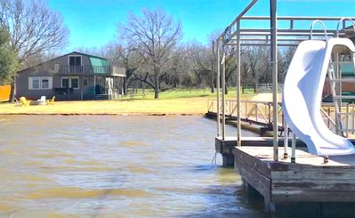 Photo for Lakefront Cabin with private Boat Ramp, Dock and Balcony