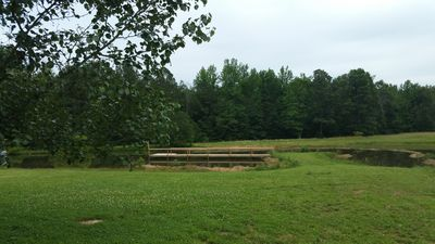Photo for Nana's Cabin- Secluded, Beautiful, on a Stocked Pond with Paddleboats!