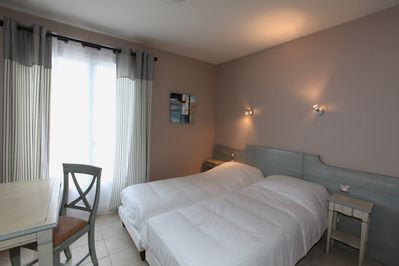 There will either be 2 Single beds or a double bed in your studio.