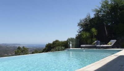 Photo for Stylishly renovated villa with heated infinity pool and sea views over Cannes