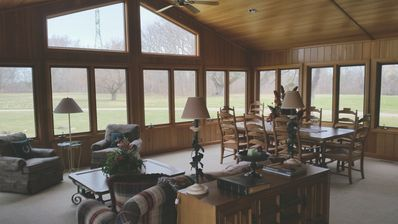 The sunroom offers dining for eight.