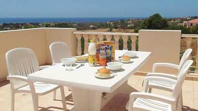 Photo for SOUTH-FACING SPACIOUS BALCONY. SEA VIEW. FULLY AIR-CONDITIONED. FREE WI-FI.