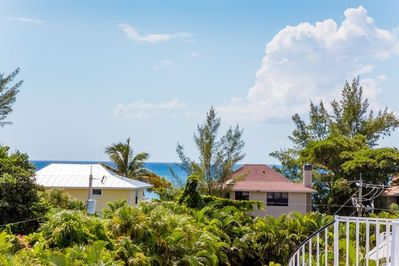 Captiva Memories is an elevated home with 5 bedrooms and 5 bathrooms and multiple sun decks with a partial view of the gulf.