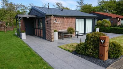 Photo for Bungalow freestanding directly on the water absolutely quiet south facing position with boat! free wifi