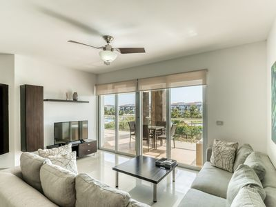 Photo for Bright condo with free WiFi and cable, full kitchen, & access to shared pool!