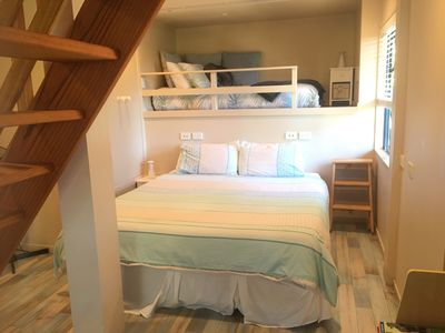 The loft bed is located behind the super king bed