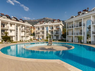 Photo for Family-friendly Maisonette Neşe Apartment with direct access to the pool