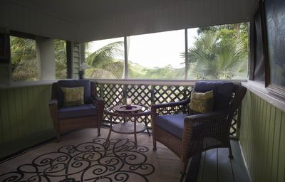 INDOOR/OUTDOOR LIVING ON THE SCREENED IN PORCH.