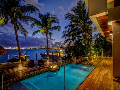 Photo for Bali Style home with Pool on the water! Rooftop basketball Court!