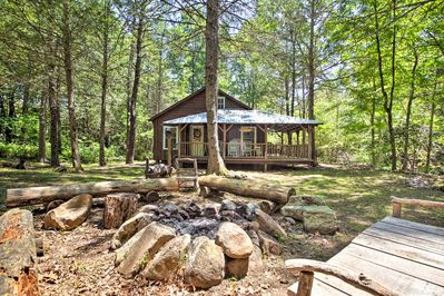 Retreat from the world at this vacation rental cabin on 10 private wooded acres!